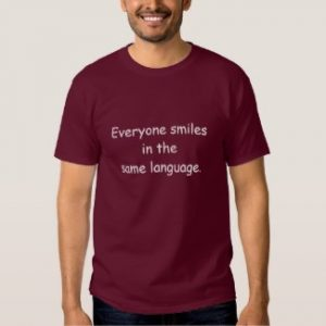 everyone smiles in the same language t-shirt maroon